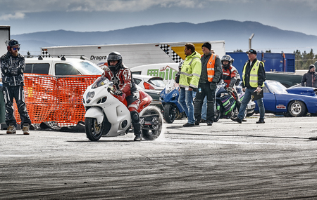 Froya, Norway, 24 June 2016: Norwegian high-skill motor sport  competitions and demonstration of fast cars drifting in Norway.Motorcycle Racing before the start.  Cars drifting, burning out, sliding, cars driving fast. Island in the Atlantic Ocean and Nor