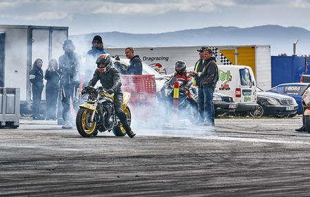 Froya, Norway, 24 June 2016: Norwegian high-skill motor sport  competitions and demonstration of fast cars drifting in Norway. Motorcycle Racing before the start. Cars drifting, burning out, sliding, cars driving fast. Island in the Atlantic Ocean and Nor