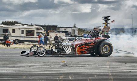 drifting: Froya, Norway, 24 June 2016: Norwegian high-skill motor sport  competitions and demonstration of fast cars drifting in Norway. Tuned car racing. Cars drifting, burning out, sliding, cars driving fast. Island in the Atlantic Ocean and Norwegian fjord. Editorial