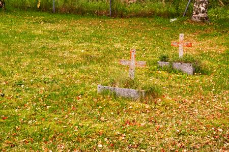 headstones: Autumn in the Norwegian cemetery. Vegetation autumn. Autumn colors. Rock disc headstones. An island in the Norwegian Sea.