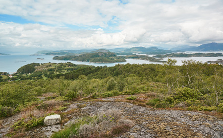 Norwegian fjords Bokna Fjord landscape located in Rogaland county. Around Stavanger. Small island Fogn. Windy day.