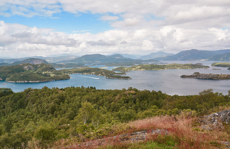 outflow: Bokna Fjord landscape located in Rogaland county. Around Stavanger. Small island Fogn. Windy day. Stock Photo