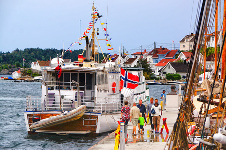 Kragero, Norway - August 9, 2014:  Bigger wooden boat festival of its kind in Norway. Maritime haven in the city of Norway Telemark. Colorful flags. Norwegian summer. Editorial