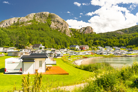 Kongensvoll Hitra, Norway - August 19, 2016:  Norwegian fjord in the summer. Colorful bay, coast of Norway. Camping and Boat Quay boat cruises on Norwegian fjord. Editorial
