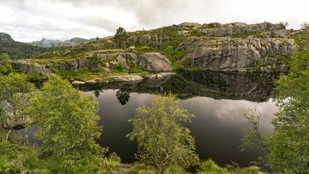 Preikestolen, Norway - July 27, 2016: Lysefjord  light fjord lightly coloured granite rocks along its sides. Extraordinary scenery of the Lysefjorden itself.  Preikestolen cliff overlooking the fjord. Editorial