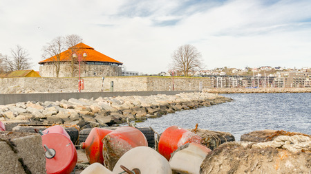 Kristiansand, Norway - June 4, 2015: Colorful sea buoys, red and orange plastic buoys. Gulf of Kristiansand. Sunny day in summer in Norway