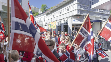 Kragero, Norway - May 17, 2015: National day in Norway. Norwegians at traditional celebration and parade.