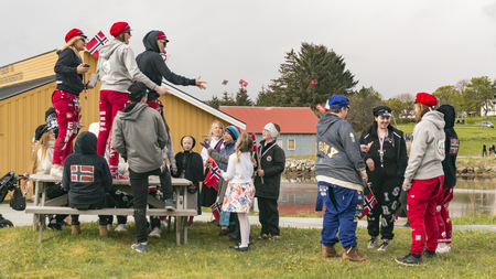 norway flag: Siholmen Froya, Norway - May 17, 2016:  Norwegian high school students in their final spring semester in the celebrations are known as russ.