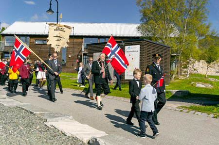 norway flag: Filan Hitra, Norway - May 17, 2017: Celebration of Norways Constitution Day. People in the Norwegian national costumes with embroidery, silver jewelry. Traditional celebration street parade.