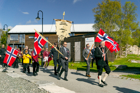 Filan Hitra, Norway - May 17, 2017: Celebration of Norway's Constitution Day. People in the Norwegian national costumes with embroidery, silver jewelry. Traditional celebration street parade.