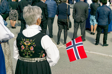 17th: Filan Hitra, Norway - May 17, 2017: Celebration of Norways Constitution Day. People in the Norwegian national costumes with embroidery, silver jewelry. Traditional celebration street parade.
