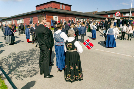 Filan Hitra, Norway - May 17, 2017: Celebration of Norways Constitution Day. People in the Norwegian national costumes with embroidery, silver jewelry. Traditional celebration street parade.