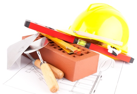 brick, tools and construction plans photo