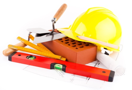 brick, tools and construction plans