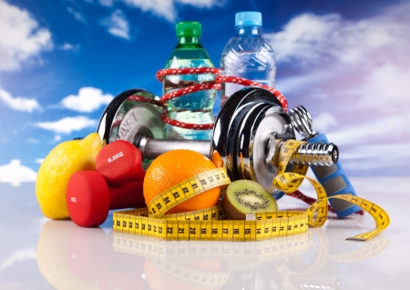 nutrition health: steel fitness dumbbells and fruits