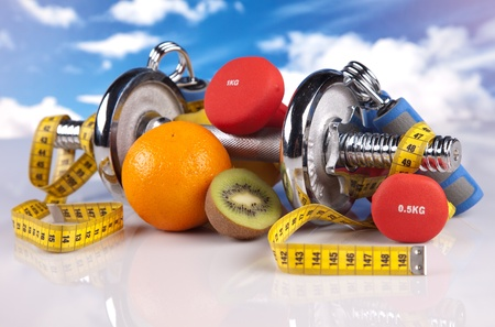 steel fitness dumbbells and fruits Stock Photo