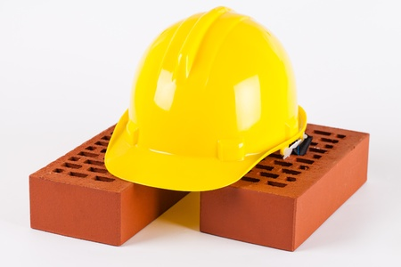 bricks and hard hat