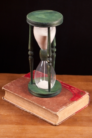 book and hourglass  photo