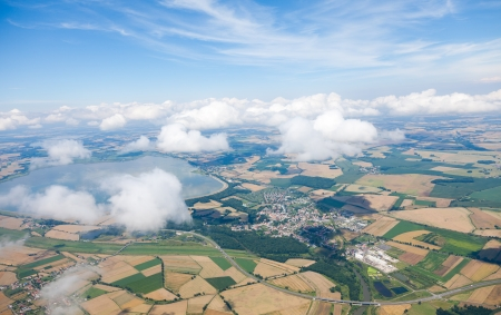 birds eye view: aerial view of village landscape with clouds