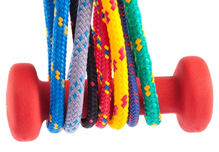 fitness dumbbells and colorful strings Stock Photo - 13767167