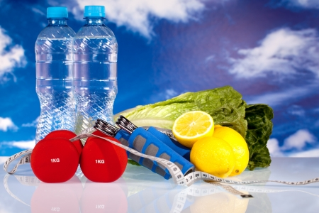 fitness dumbbells water and fruits photo