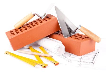 metselaar tools, bakstenen en woningbouw plannen Stockfoto