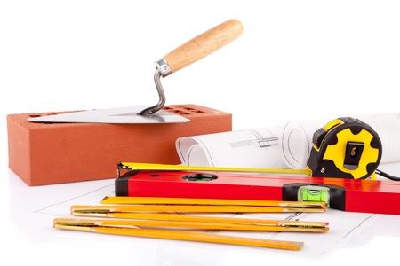 Muratore strumenti e piani di costruzione della casa Archivio Fotografico - 15453698