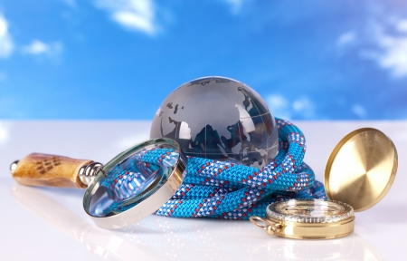 crystal globe compass and blue rope photo