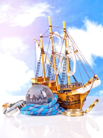 compass sailing ship and magnifying glass  Stock Photo - 15454232