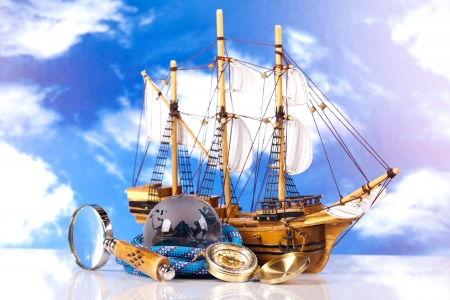 compass sailing ship and magnifying glass  photo