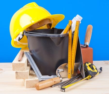 yellow hardhat and mason tools  Stock Photo