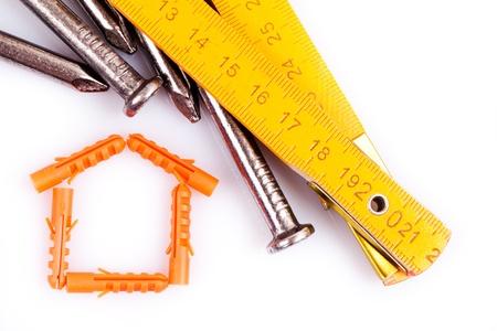 house symbol and nails  photo