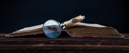 old book and magnifying glass Stock Photo - 18166041