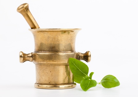 closeup of brass mortar with spices isolated on white background  photo
