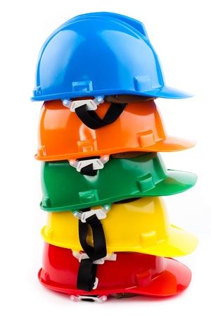 baustellen: bunte Sicherheit hardhats isoliert auf wei�