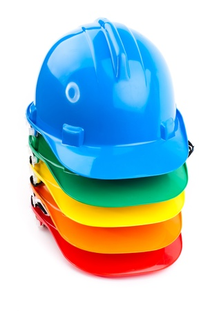 safety colorful hardhats isolated on white