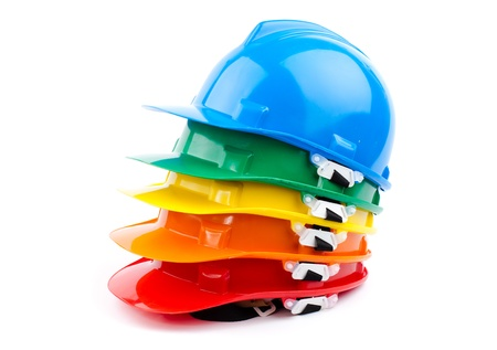 mine site: safety colorful hardhats isolated on white