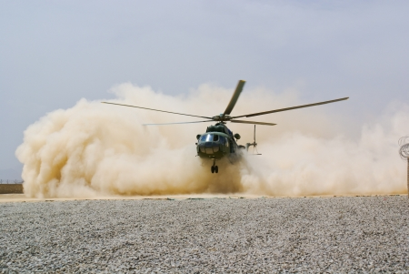 helicopter landing in cloud of dust