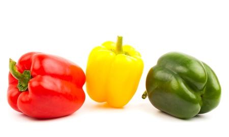 colorful paprika isolated on white background photo