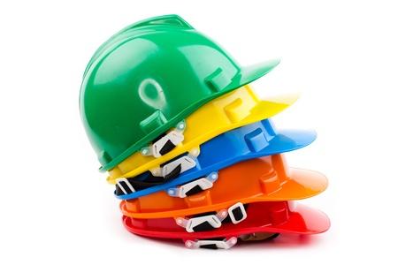 Mucchio di elmetti protettivi di sicurezza colorati del costruttore Archivio Fotografico - 18472243