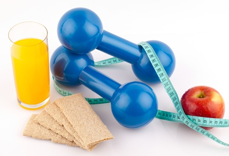 fitness equipment and healthy food isolated on white Stock Photo - 18472274