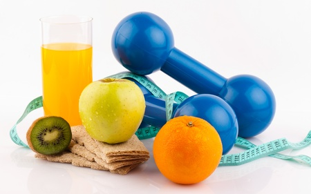 fitness equipment and healthy food isolated on white  Stock Photo - 18472252