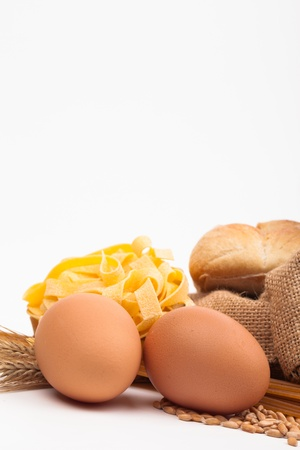 egg and pasta assortment isolated on white background Stock Photo - 18166359