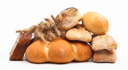 assortment of baked bread on white background  Archivio Fotografico