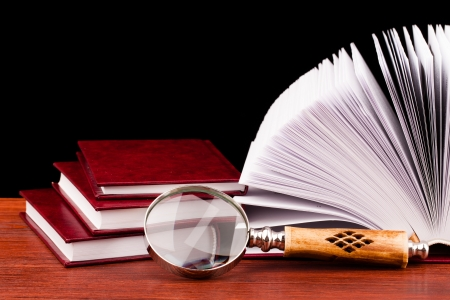 books of justice and magnifying glass  photo