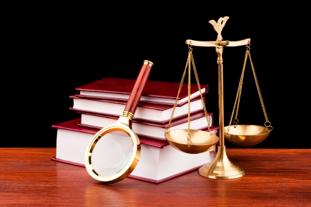books of justice ,scale and magnifying glass