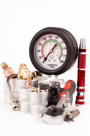 pressure gauges and tools isolated on white photo