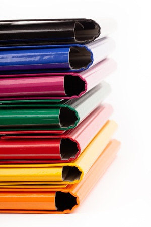archiving: colorful office folders isolated on white