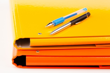 dossier: colorful office folders isolated on white