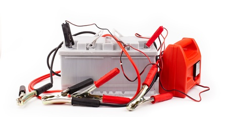 12v: Car battery and jumper cables isolated on white